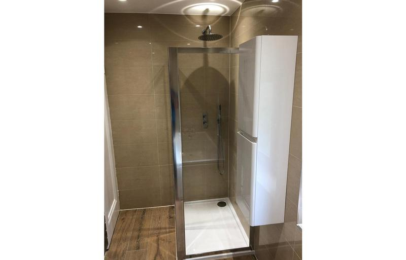 Image 2 - Built in shower into a small modern bathroom creating extra floor space.