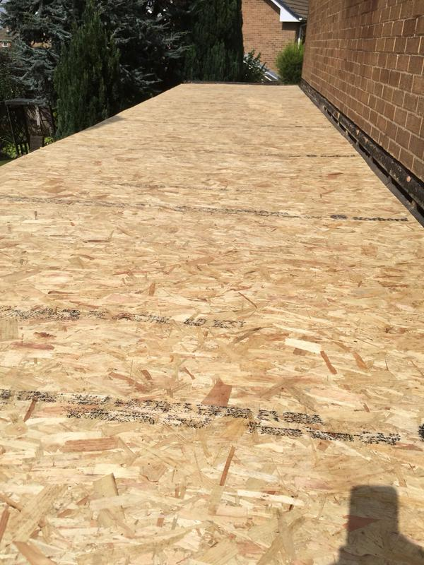 Image 5 - Before the rubber can be laid a layer of OSB boarding is secured to strengthen and protect the underneath beems batons and existing roof
