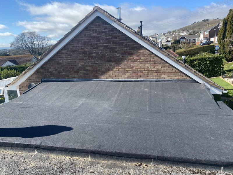 Image 5 - New roof and joined to next doors roof 3 layer high performance torch on polyester felt system mineral finish guaranteed 10 years life expectancy 35/40 years