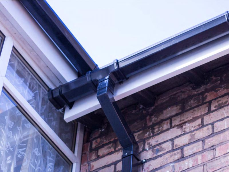 Image 164 - This customer preferred black guttering on her white fascia and soffits, all customers like there own design work upon there home.