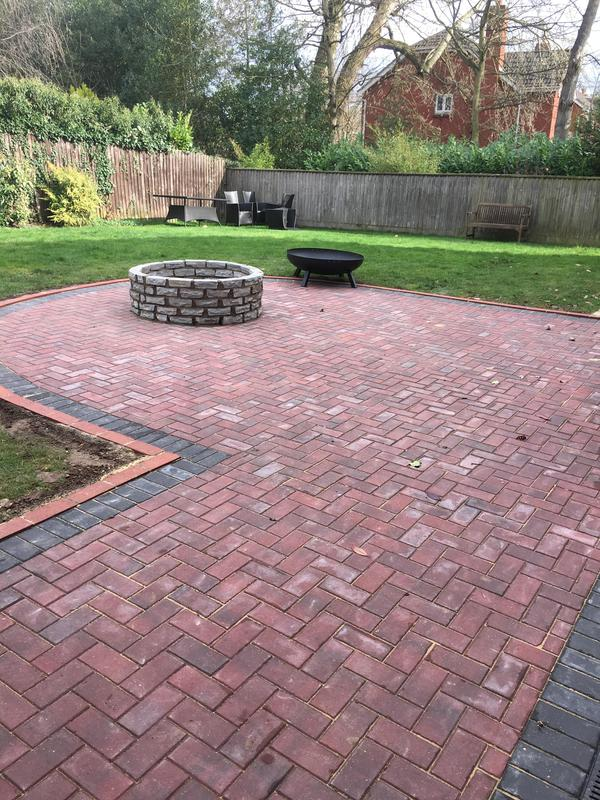 Image 206 - Block paving patio brindle colour with charcoal border and freestanding natural sandstone fire pit area