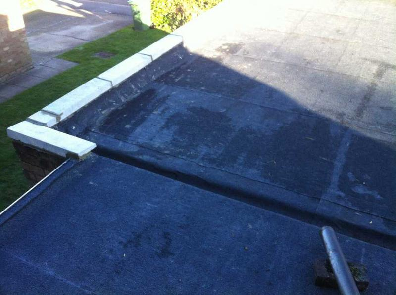 Image 36 - new flat roof installed with coping stones