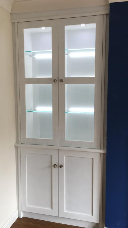 Image 9 - Bespoke alcove cabinets with LED glass shelf lights and recessed downlighting.