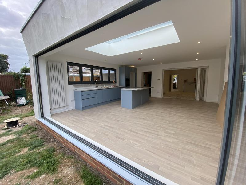 Image 66 - Basalt grey bifold windows and 5.5m bifold doors