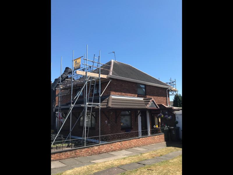 Image 151 - Large detached home installed with the smooth grey Ludlow tiles in dry verge not the wet fix.