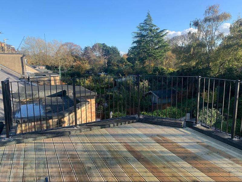 Image 20 - Roof decking & new matal handrails to 1st floor flat roof.