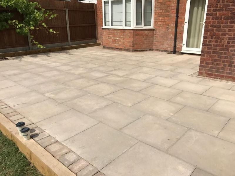 Image 64 - patio area using plain grey slabs and blocked edge