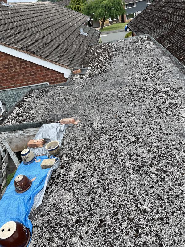 Image 21 - Before and after pictures of a felted flat roof that was completed