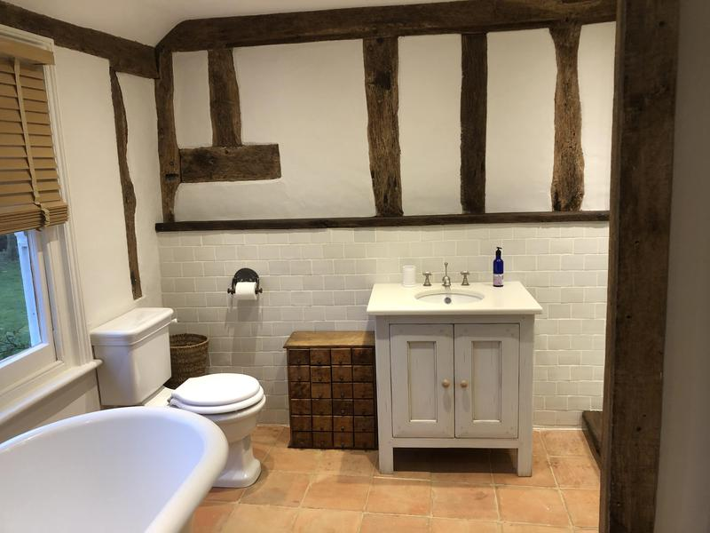 Image 27 - A lovely en-suite I've just completed. A full redec including skimming ceiling lots of work on the beams repainting the entire room walls ceilings sash windows plus a lot of work enhancing the floor and sealing it etc Grade Ii* property