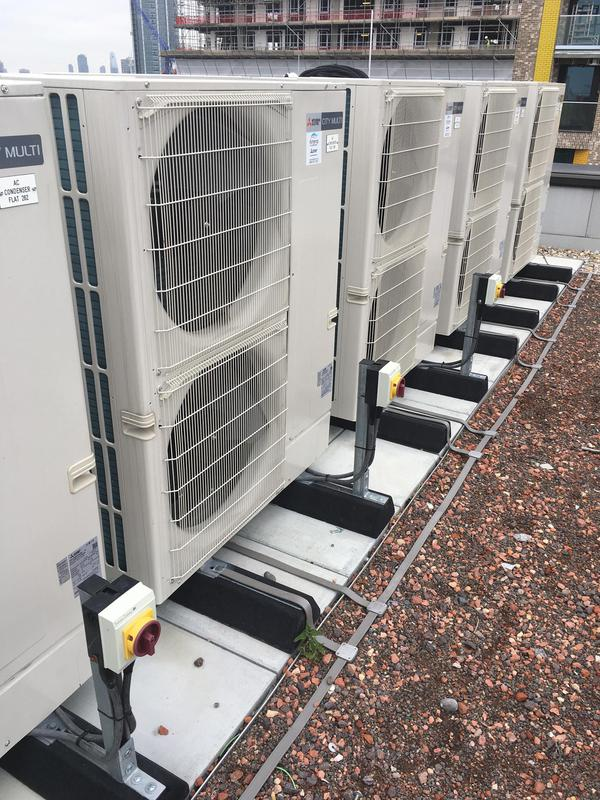 Image 55 - Air con units installed on roof off block of flats.