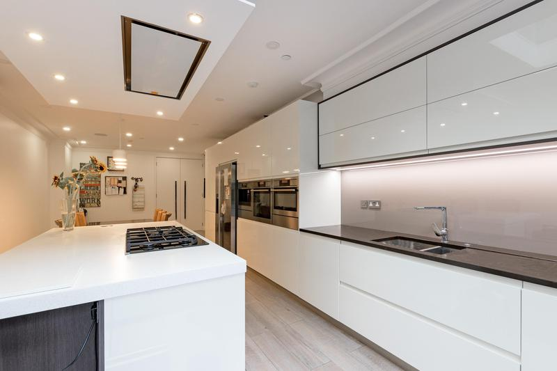 Image 38 - Bespoke bulk head and installed new kitchen, tled and painted