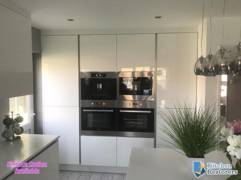 Image 8 - Full True Handle-less Kitchen FittedDoor Colour: Acrylic High Gloss WhiteWorktop: Solid Surface Peak