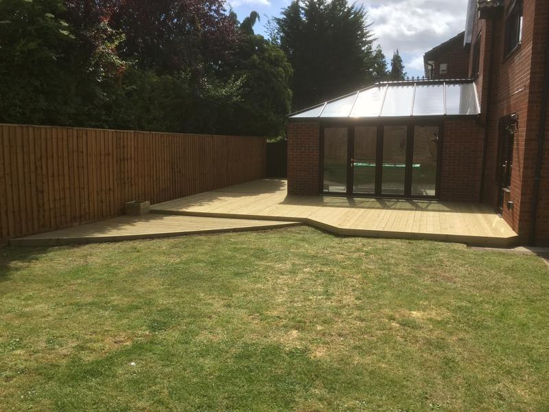 Image 8 - A large decking area around a conservatory and feather board fencing in bramingham