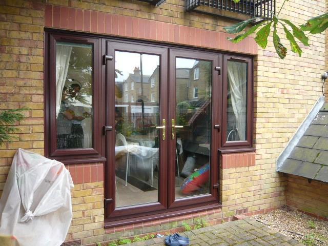 Image 1 - Woodgrain upvc french doors