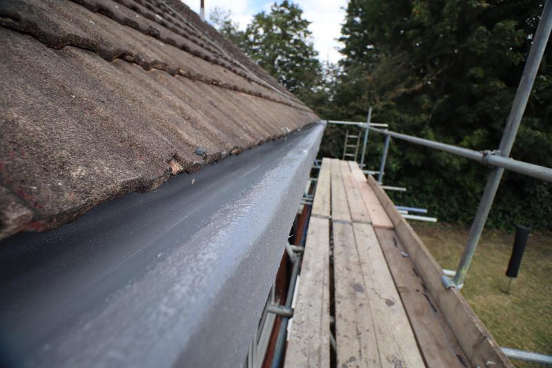 Image 35 - Rubber liquid applied over concrete guttering