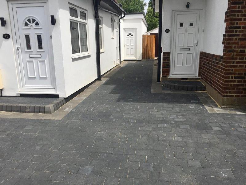 Image 15 - Double block paved driveway using Marshalls Drivesett Savanna in charcoal with a pennant grey border