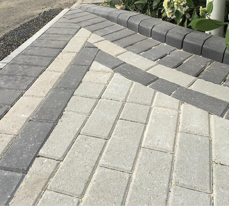 Image 212 - Natural stone grey block paving driveway with charcoal border