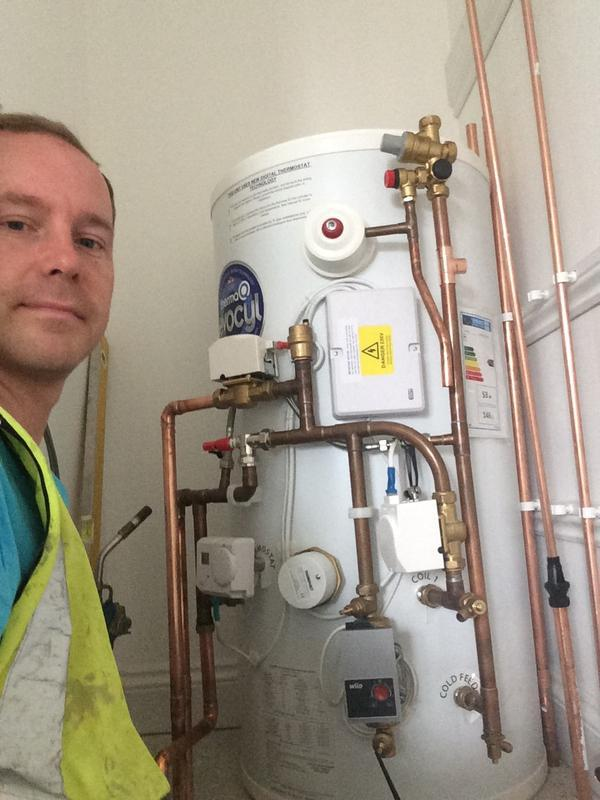 Image 35 - Me, installing a new unvented cylinder