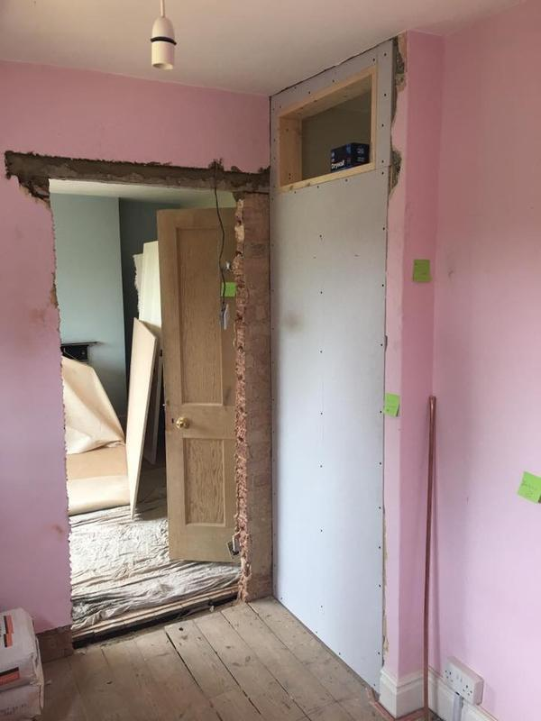 Image 13 - This customer needed walls and ceilings rebuilt and replasterd, doors repositioned.  We work closely with other trades to makes sure projects go as smoothly as possible.