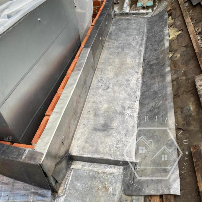 Image 15 - Repairs to old lead sheets and new code 8 gutter with flashings