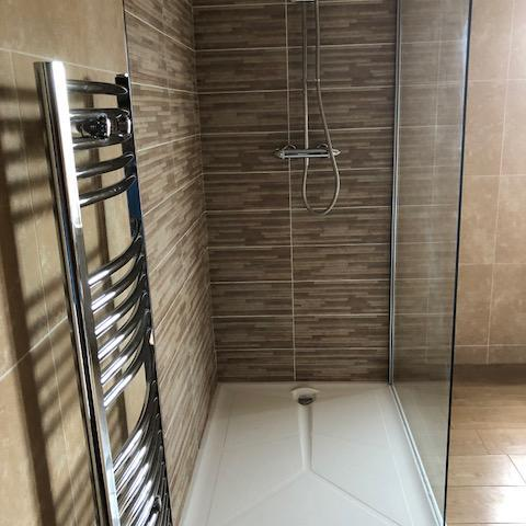 Image 4 - Low level walk in tray (40mm), full height glass panel, thermostatic mixer shower and contrast tiling to shower area.