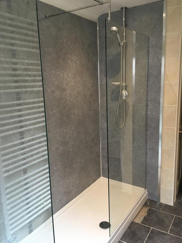 Image 55 - A bath replaced for a shower with splash boards over the tiles