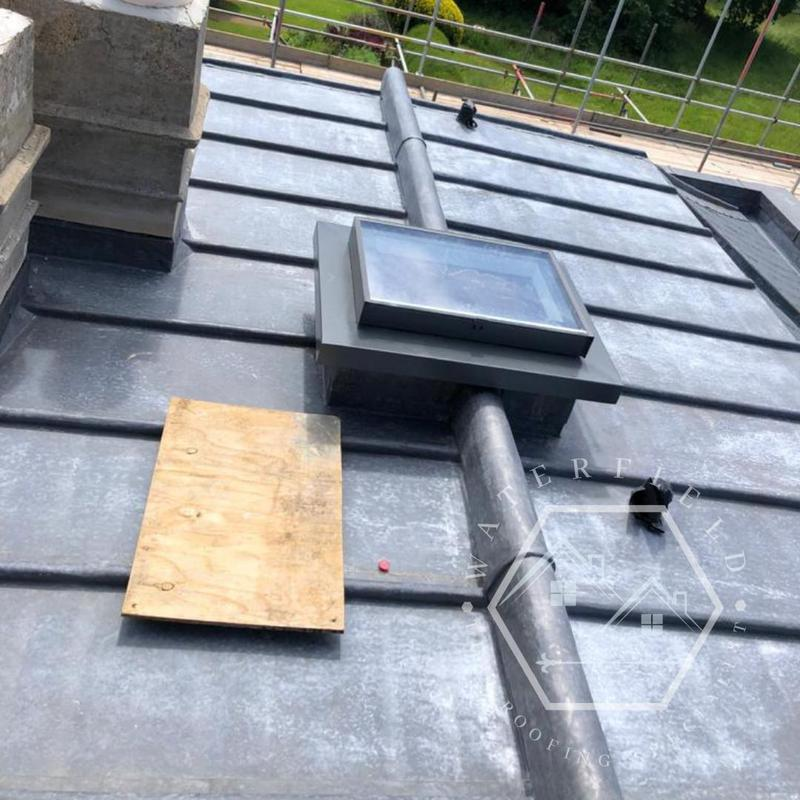 Image 32 - Code 8 flat roof with welted half circle ridge detail,