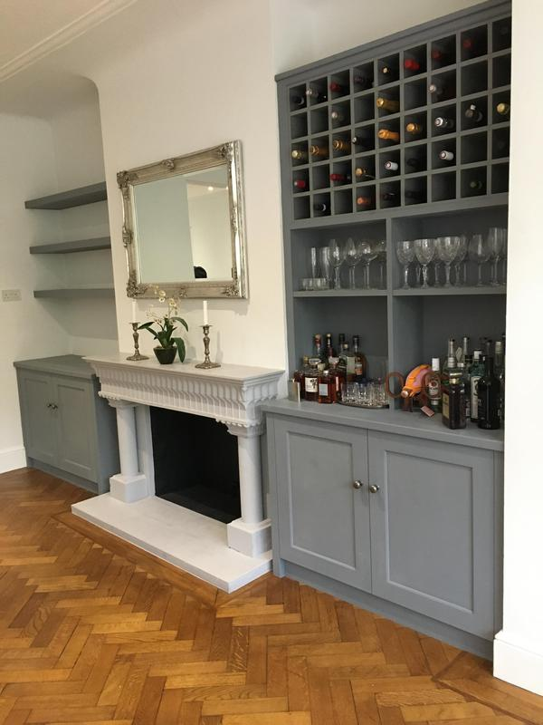 Image 1 - Bespoke alcove cabinets incorporating wine storage area and floating shelves .