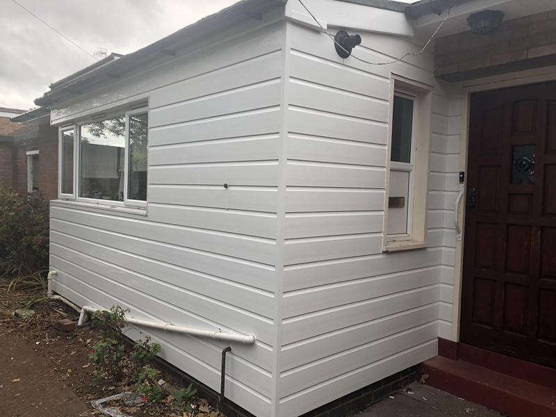 Image 3 - White external cladding installed to fully replace 50 year old rotten timbers.Tra