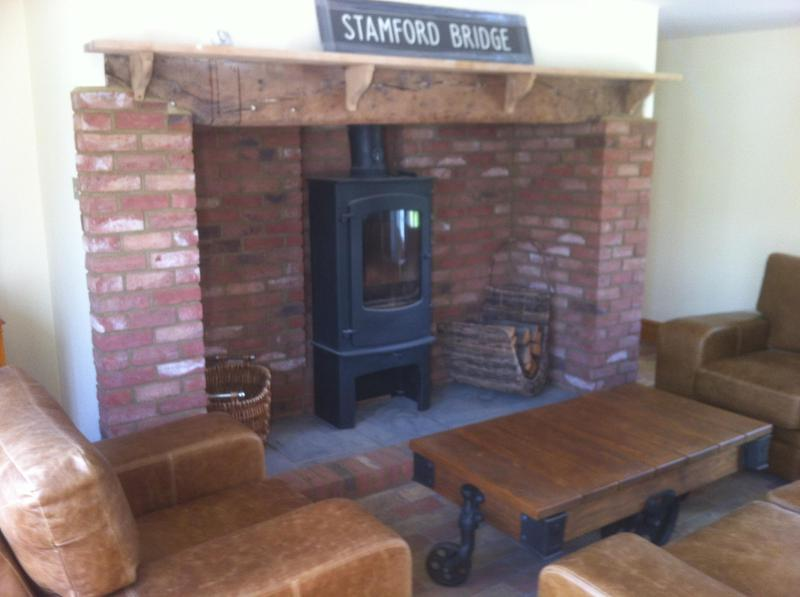 Image 17 - Brick slips installed and wood burner fitted
