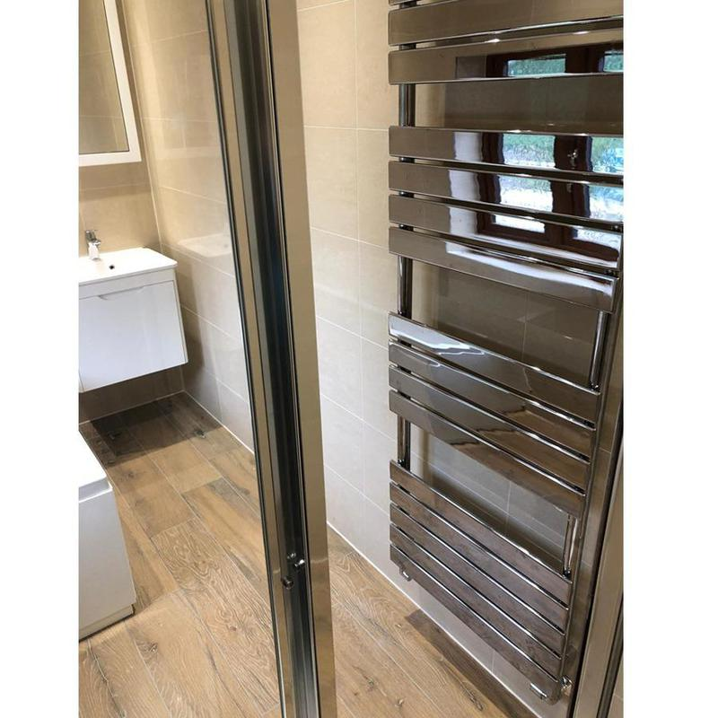 Image 3 - Wall hung heated towel rail in small modern bathroom, making the most of wall space.