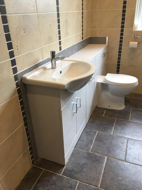 Image 56 - A toilet and basin vanity unit replacing a toilet and basin