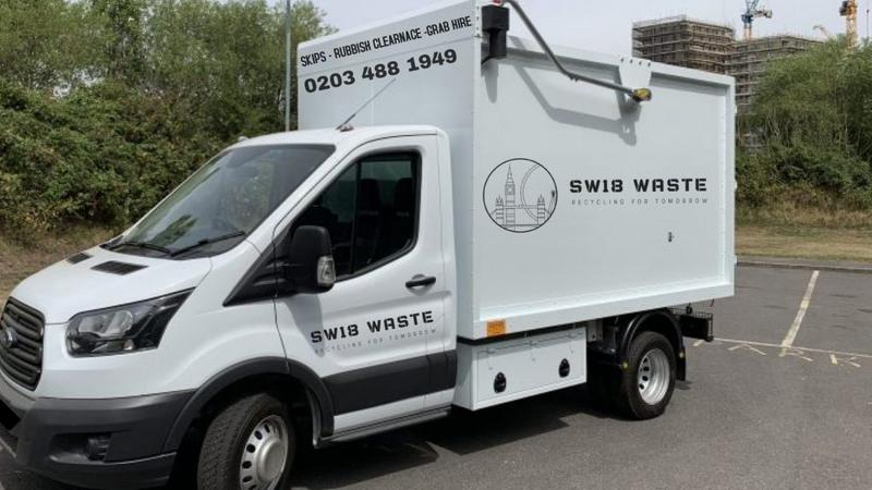 Image 12 - One of our inclosed waste collection trucks.