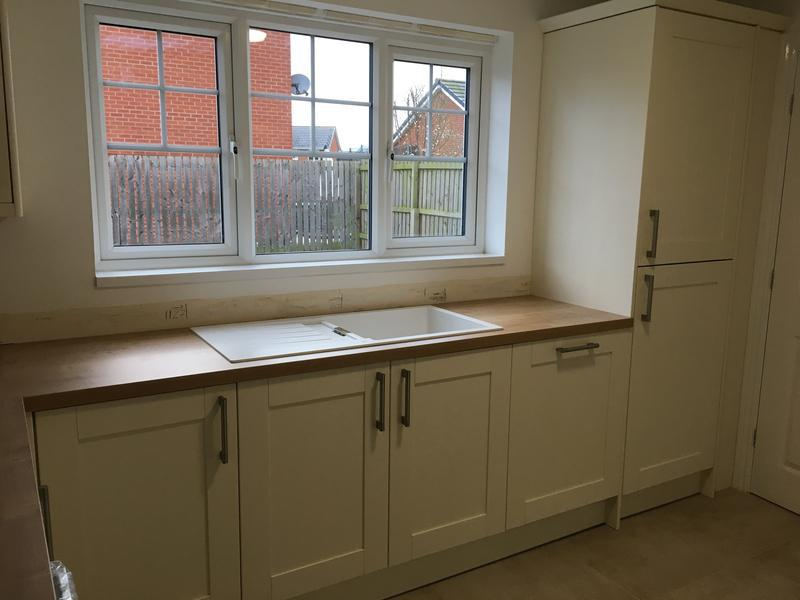 Image 11 - A nice contemporary kitchen finished with a cream shaker door and a oak laminate worktop and in the tall larder unit is a integrated fridge freezer