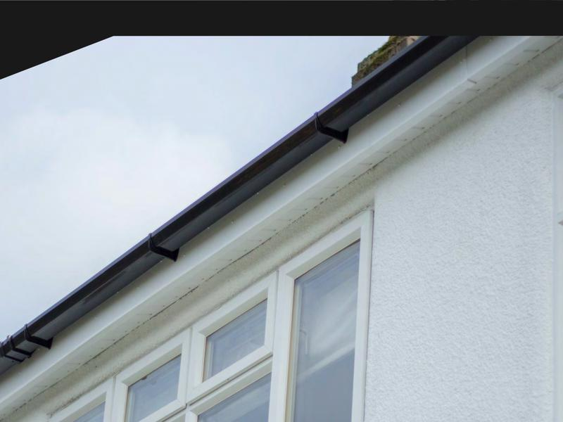 Image 165 - Black guttering upon the white fascia.
