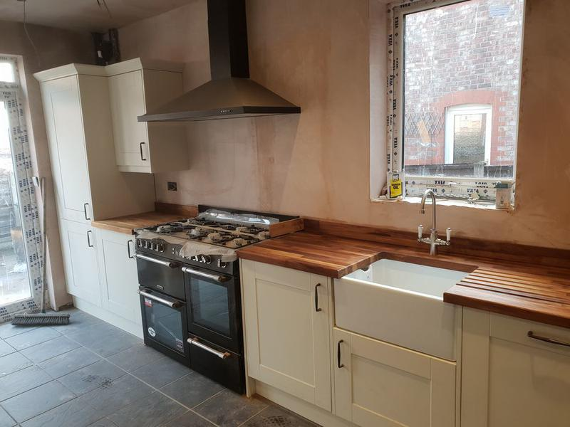 Image 13 - Wren kitchen installation with soild oak worktops Nelfast sink cut out and drainer grooves.