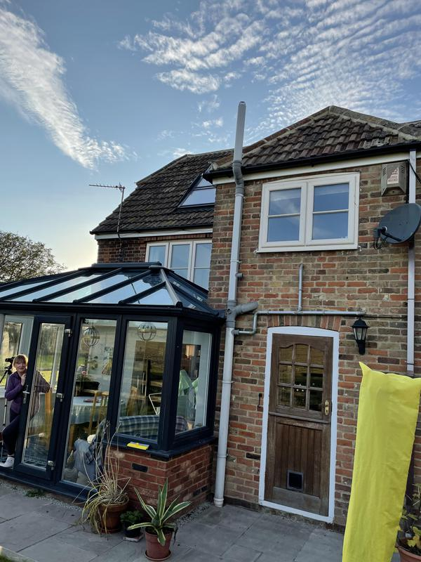 Image 2 - New roof relayed using existing tiles and upvc work