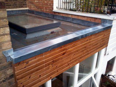 Image 2 - New flatroof and rooflight. Code 4 lead to form new parapet detail.