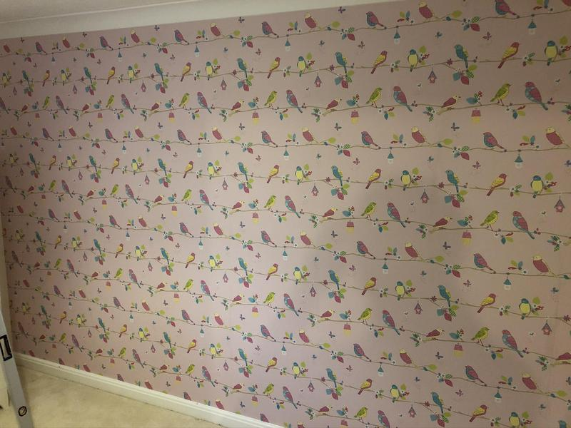 Image 2 - A feature wall paper hung.