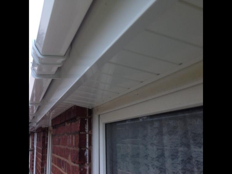 Image 162 - A close up photo of white square guttering with Heavy duty tongue and groove soffit and plain fascia.