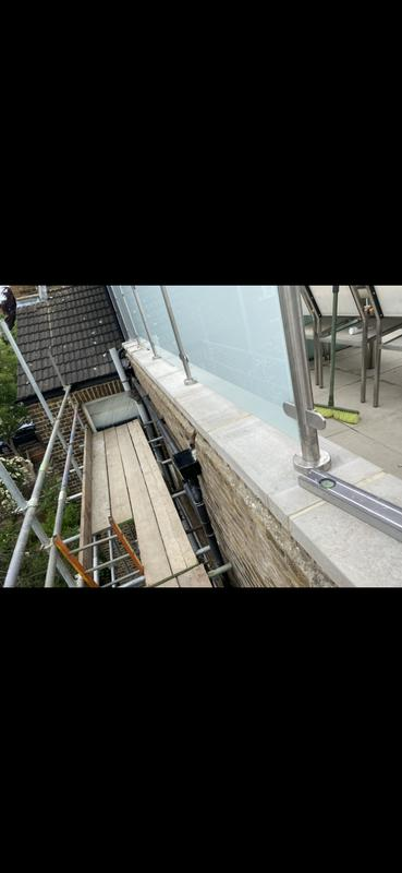 Image 29 - After, fitting new DPC and coping stones re-fixing glass and bannisters.