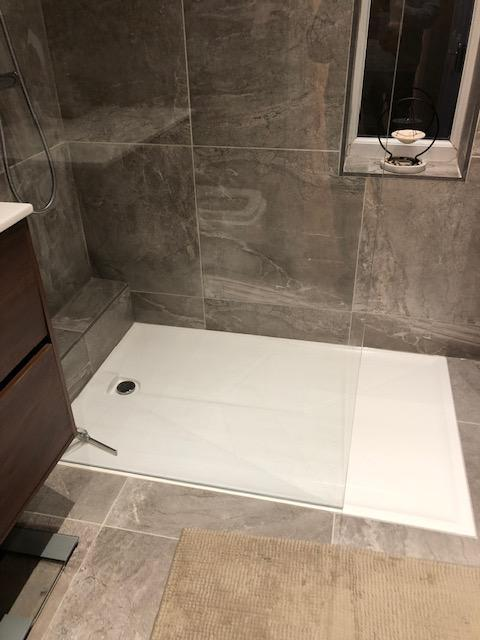 Image 12 - Low level walk in shower and full height glass panel. Includes matching existing tiles.