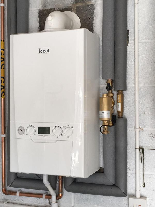 Image 15 - Boiler fitted in garage