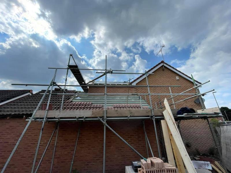 Image 12 - Ashton Double Story Extension - During - Scaffolding and roof work progress