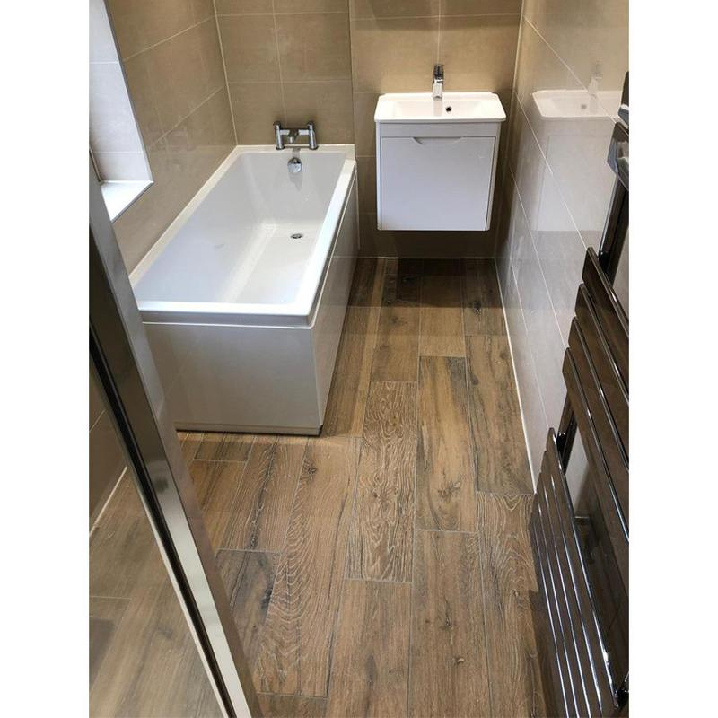 Image 4 - Small modern bathroom with a shower and bath and a towel radiator fitted.