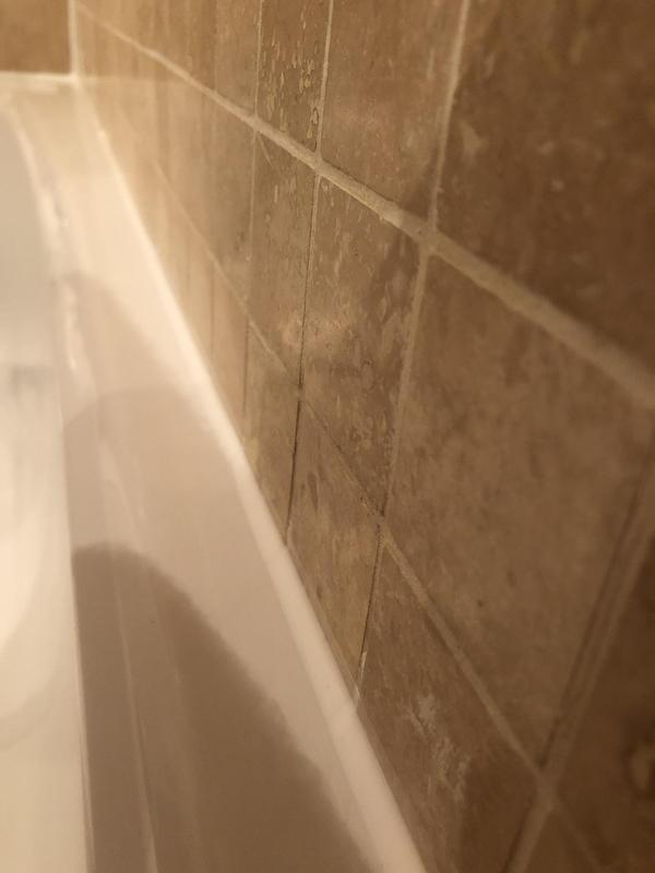 Image 28 - Re-siliconed around a bath