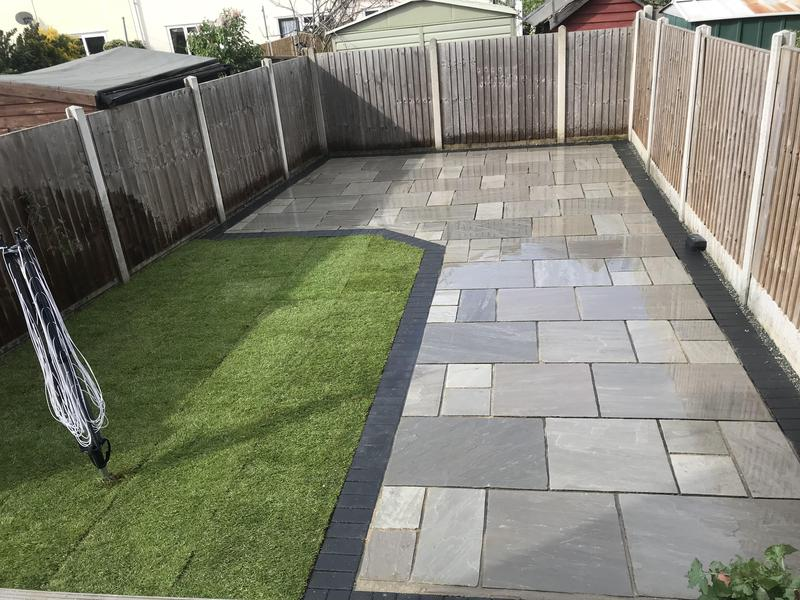 Image 20 - Back patio sandstone grey with charcoal bourders fr