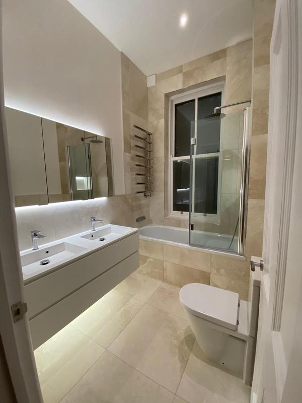 Image 18 - AFTER. Bathroom renovation, Hampstead.Re-piping, tiling fully walls, bath area and floor, wall unit installation, LED strip around wall unit and sink