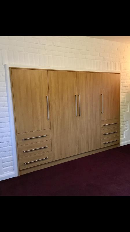 Image 35 - Bespoke wardrobes built into an old fireplace.