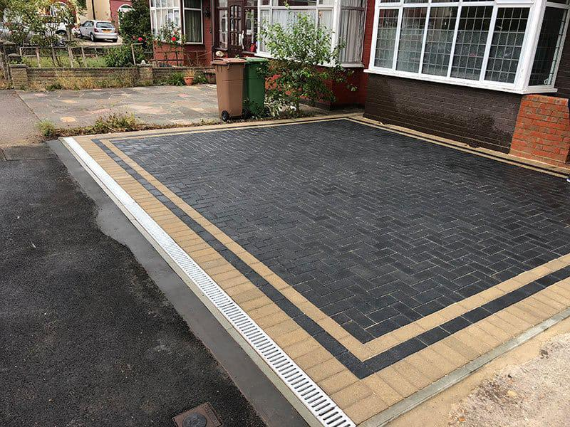 Image 135 - Grey block pavers With buff borderline With acro drains at front